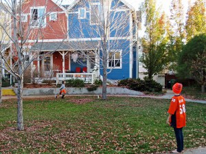 Simon Leff (right) and Noah Alleman tosses a ball in the shared green space at Hearthstone Cohousing.